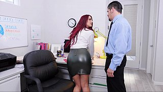 Redhead gets her pussy licked at the office