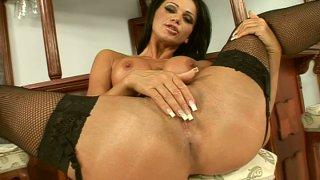Zesty brunette Christina Bella shows off her goodies and masturbates